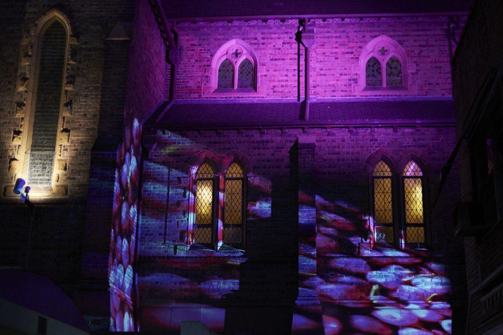 purple artistic lighting on a church wall